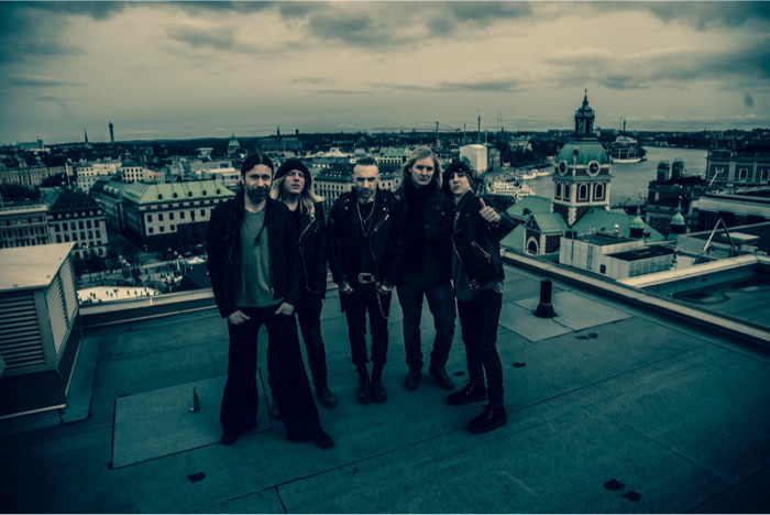 Backyard Babies and I standing on a rooftop in Stockholm.